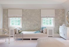 chinoiserie wallpaper and chaise int he bedroom