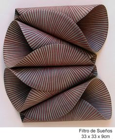 Yes it's clay. Maria Oriza: modern ceramic sculpture and wall panels.