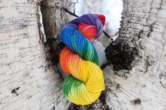 Hand dyed superwash worsted weight rainbow yarn by Arctickrafts