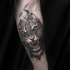 Freshly done, black and gray tiger on mans arm.  Artist John Logan. #lion #liontattoo #tattoo #wildlife #realistic #realism #animal #animaltattoo #armtattoo #blackandgray #blackngray #riga #tattooinriga #sporta2 #tattooed #tattooist #tattooart #art #tattooink  #ink #inked #skin #tattooartist #tattoofrequency #share #like #follow