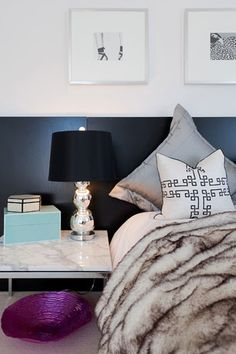 """Eisen often calls on """"unexpected touches"""" when she's styling a home. Here, she created a dramatic headboard with inexpensive Ikea desktops propped against the wall. The headboard's dark hue really pops against the light wall. My New Room, My Room, Home Bedroom, Bedroom Decor, Lux Bedroom, Serene Bedroom, Master Bedrooms, Home Look, Cheap Home Decor"""