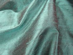 """Thai Silk Dupioni - Turquoise (iridescent turquoise with brick). 100% Silk. 44"""" wide. Dry clean. Priced per yard."""