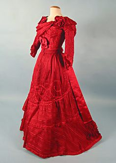 Beautiful red monochromatic dress, ca. 1890. It has some unusual draped fabric at the neckline.