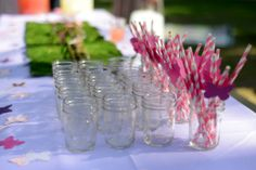 Butterfly theme - First Birthday Party - mason jars w/ pink straws and butterflies