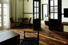 American Trade Hotel | Luxury Boutique Hotel in Casco Viejo, Panama City, Panama - Rooms #acehotelpanama #blackpaintedfrenchdoors #woodflooring
