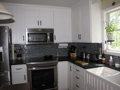 black and gray backsplash- goes well w/ white cabinets and stainless steel appliances