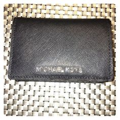 Michael Kors Wallet Black Michael Kors wallet. In good condition with little to no marks on it. The button is a little more loose than it was when it was first purchased, but it still clasps. Michael Kors Bags Wallets