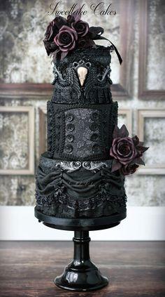 Black gothic wedding cake with raven skull cameo
