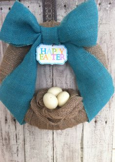 Adorable Burlap Easter Egg Wreath. $43.95, via Etsy.
