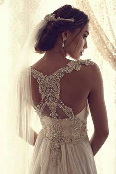 Love both the back of the dress and head piece