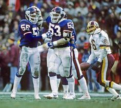 Giants (Lawrence Taylor #56, Harry Carson #53) at Washington December 17, 1983
