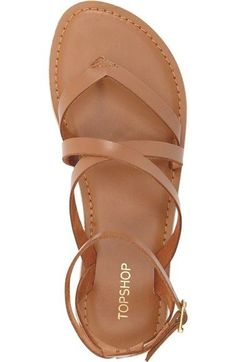 Free shipping and returns on Topshop 'Hercules' Strappy Leather Thong Sandal (Women) at Nordstrom.com. A flat leather thong sandal is styled with crisscrossing straps and a buckled ankle strap.