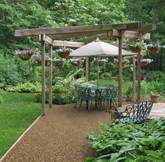 This uniquely shaped floating deck is large enough to support multiple focal points, from the dining area beneath a gazebo structure to the garden-backed bench seat area. Pergola Swing, Backyard Pergola, Gazebo, Pallet Pergola, Garage Pergola, Deck Patio, Outdoor Pergola, Outdoor Dining, Pergola Attached To House