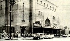 """For children, the Temple Theatre was the place to be on Saturday. It was not uncommon for lines of children waiting to see the latest western to wrap all the way around the block. On this particular Saturday,  """"Snow White and the Seven Dwarves"""" and """"The Three Stooges"""" were on the bill. The Temple Theatre is located on the corner of Eighth Street and 24th Avenue."""