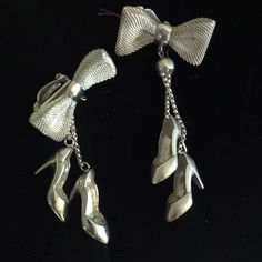 """SOLD!!--Dancing Shoe Earrings--Roll back the rug and put on the music to your ears! These little dancing shoe earrings will put that extra swing in your step! One of a kind--Sterling silver 1-1/4"""" high heeled pumps dangle from 2-1/2 """" of chain, suspended by beautiful sterling silver mesh bows! Sterling silver clips make them the most comfortable earrings you have. #shoes #highheels #dancinwiththestars #dancing #ballroom #swing #ballet #jazz #pumps #stilletos"""