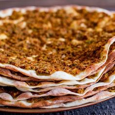 Lahmacun or Turkish Meat Pies, known as Turkish pizza, but so much better. A thin piece of homemade dough topped with minced meat and vegetables.