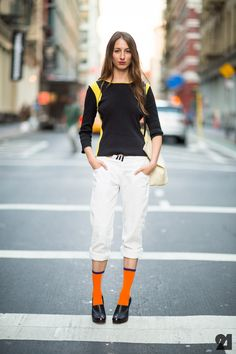 A pop of orange can make you stand out on the street