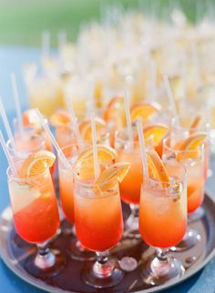 For daytime weddings, opt for cocktails with light, bright citrusy flavors. We're thinking a riff on a tequila sunrise is sure to lure guests to the bar. Image Source: Jodi McDonald Photography via Style Me Pretty Wedding Signature Drinks, Signature Cocktail, Orange Wedding Themes, Orange Weddings, Summer Weddings, Wedding Orange, Tangerine Wedding, Destination Weddings, Sunrise Wedding