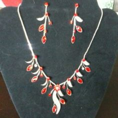 "HPRed Statement Necklace/ earrings set This is perfect to compliment any Christmas outfit. Smart & Shiny. This is a must for any holiday glitter & glam. Wardrobe Staple Host Pick Silver plated chain has bright red Crystal flower for center piece and red crystal buds with silver mesh  ""leaves "". Measures 14"" w/ 4"" extender. Earring are 2"". Beautiful work. New, never worn, no tag...make a reasonable offer, you may be surprised on what I may accept Boutique Jewelry Earrings"