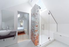 Architect Gavin Smith worked with a Boston-based company, Artaic, on the mosaic tile in the master bathroom in the renovated attic in his century-old Craftman-style house in Seattle.
