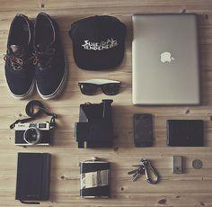 Macbook, shades, camera, hat and more...all essentials