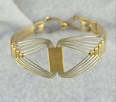 This listing is for the TUTORIAL ONLY for the Egyptian Bracelet as shown. It is a .pdf file and has over 14 pages of instructions with 36 detailed photographs and hints PLUS a special 3 page Bonus feature on how to make pretty wraps. The instructions are in ENGLISH ONLY. All the