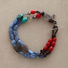"""IMPRESSIONIST' BRACELET--Inspired by Cezanne landscapes, Naomi Hearndon knots red African barrel beads, faceted labradorite ovals, kyanite, turquoise and sterling beads on soft leather, with a toggle closure. Handcrafted exclusively for Sundance. 7-1/2""""L."""