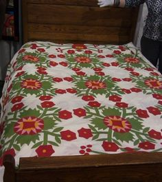 Red and green quilts were very popular in the 1840′s – 1870.  This one has some added cheddar.