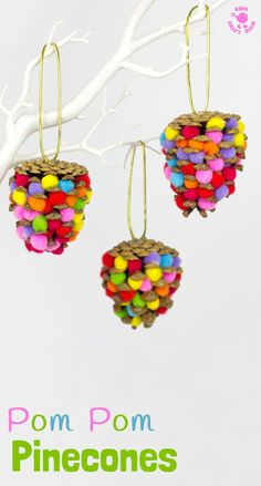 POM POM PINECONES - This colourful Pom Pom Pinecone craft for kids looks great! Use this nature craft to make Christmas ornaments or as pretty mobiles all year. There's even a fun idea for a colourful pinecone math game too. #naturecrafts #pineconecrafts #pompomcrafts #kidscrafts #craftsforkids #kidsactivities #kidscraftroom #christmas #christmasornaments #ornaments