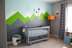 Modern Adventure Themed Nursery - love the rustic, mountain mural!