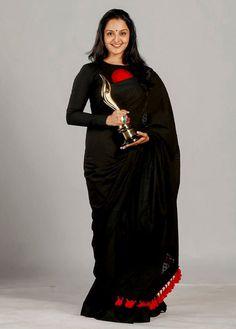 Manju warrier in jet black handloom saree with red thread embroidery. Black Cotton Saree, Black Saree, Pakistani Outfits, Indian Outfits, Saree Jacket Designs, Saree Jackets, Best Blouse Designs, South Indian Sarees, Saree Trends
