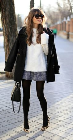 Long light sweater + short full skirt + black tights + light/printed footwear add up to a pretty, polished look. -Lily