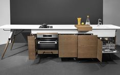 Serbian brand Dsignedby has packed all the appliances needed for cooking into this space-saving wooden kitchen island, the Kitch& cabinet.