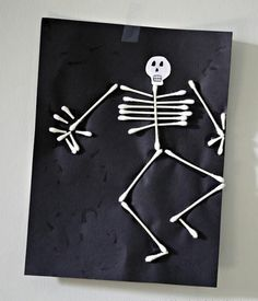 Cute skeleton made out of Q-tips. Cheap and easy to make. :]