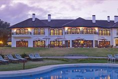 Fairmont Mount Kenya Safari Club is situated on the foothills of Mt. Kenya, 10 km's from Nanyuki Town, a good 3 hour drive from Nairobi on tamac road. Mount Kenya, African House, Kenya Travel, Fairmont Hotel, Mega Mansions, Hotel S, Nairobi, Great View, Hotels And Resorts