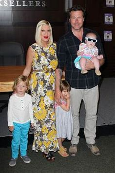 Tori Spelling and husband actor Dean McDermott pose with their children (L-R) Liam, Stella and Hattie. The soon-to-be mom of four chatted with TODAY Moms about why we should all be making our own play dough, how she embarrassed herself at Liam's graduation, who in her family is rooting for another girl. (photo: David Livingston / Getty Images)