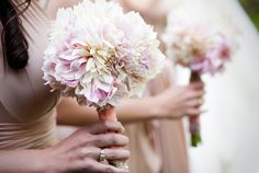 Bridesmaids bouquets with all cafe au lait dahlias. The color just blended so beautifully with the nude colored gowns from two birds bridesmaids.