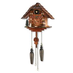 Chalet Cuckoo Clock | NatGeoStore | frogs Germany's Black Forest  nearby Swiss Alps since the mid-18th century»wooden chalet-style clock features young accordion player in traditional dress,  Saint Bernard carrying a barrel of brandy(which is a staple of Alpine folklore)