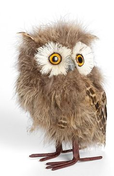 """Genuine feathers bring lifelike dimension to a handmade owl figurine sure to be an eye-catching conversation piece. 6 1/4"""" height. Handmade. Feather/wire/Styrofoam/paper. By Jim Marvin; imported"""