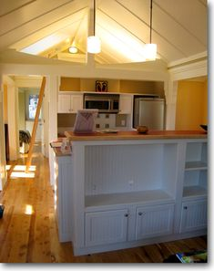 Pinner before: adorable open floorplan.. living room to kitchen with bedroom loft above. very cute!