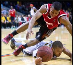 Darren Duncan fights to get the ball from London Lightning's Garrett Williamson during Game 4 in London.