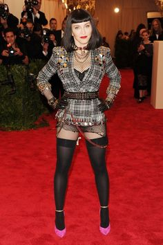 Attention getting, Madonna in belted blazer by Givenchy Couture by Riccardo Tisci  with tights, no skirt or pants!
