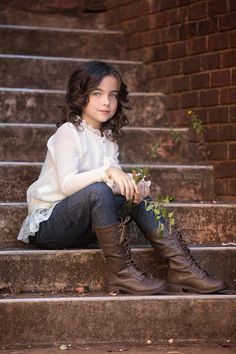 Photo of girl sitting on stairs.                                                                                                                                                                                 More
