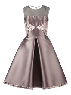 Mauve sleeveless dress from Giles featuring a round neck, a brown chest section, two white triangular panels with a black abstract print, a cinched waist, a large central front pleat, a white and black printed hem, a large central rear pleat, and a back zip fastening with a key-hole detail.