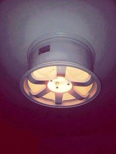 Place a lamp holder on to an extra alloy wheel and hang to ceiling - original light fixture