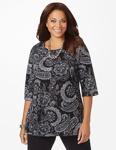 Our extra-long Easy Fit Tees offer relaxed comfort and laid-back style. A large, scrolling paisley print covers this soft tee. The breathable fabric, paired with the comfortable scoop neckline and three-quarter sleeves, make this top ideal for all-day wear. Catherines tops are designed for the plus size woman to guarantee a flattering fit. catherines.com