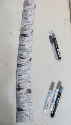 Lastly, add a thin black line up the left side of the tree trunk using the black marker.