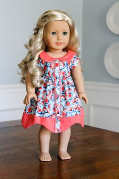 Blue and Coral Flowered Dress by SparrowAndWrenMerc on Etsy. Made with the Bluebelle Dress pattern, found at http://www.pixiefaire.com/products/bluebelle-dress-18-doll-clothes. #pixiefaire #bluebelledress