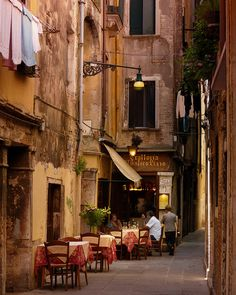 Sidewalk Cafe, Venice, Italy.  Always the laundry in poor sections of Italy. I ate in wonderful cafes there.