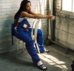 My mom used to dress like this aha! The style is, I know Aaliyah wasn't :)